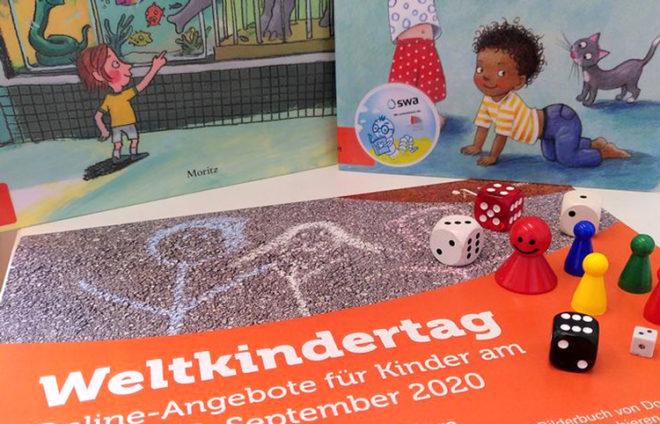 Kinderbücher, Spielfiguren und Flyer zum Weltkindertag